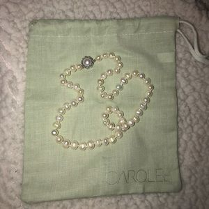 100% fresh water pearls with sterling silver clasp
